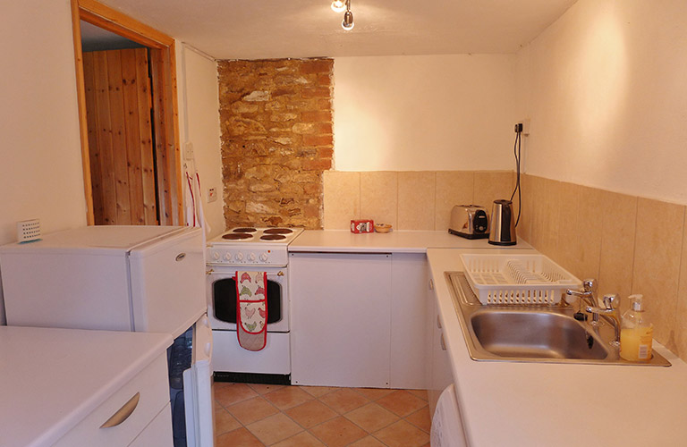 Kitchen complete with an electric cooker, sink, microwave , fridge and freezer