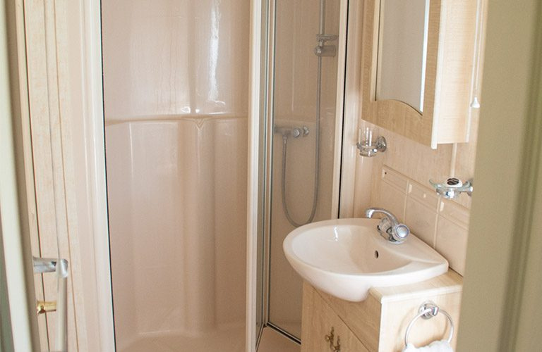 Bathroom in the mobile home, sink, shower and toilet