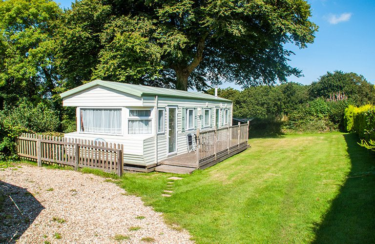 Mobile home view with lawn