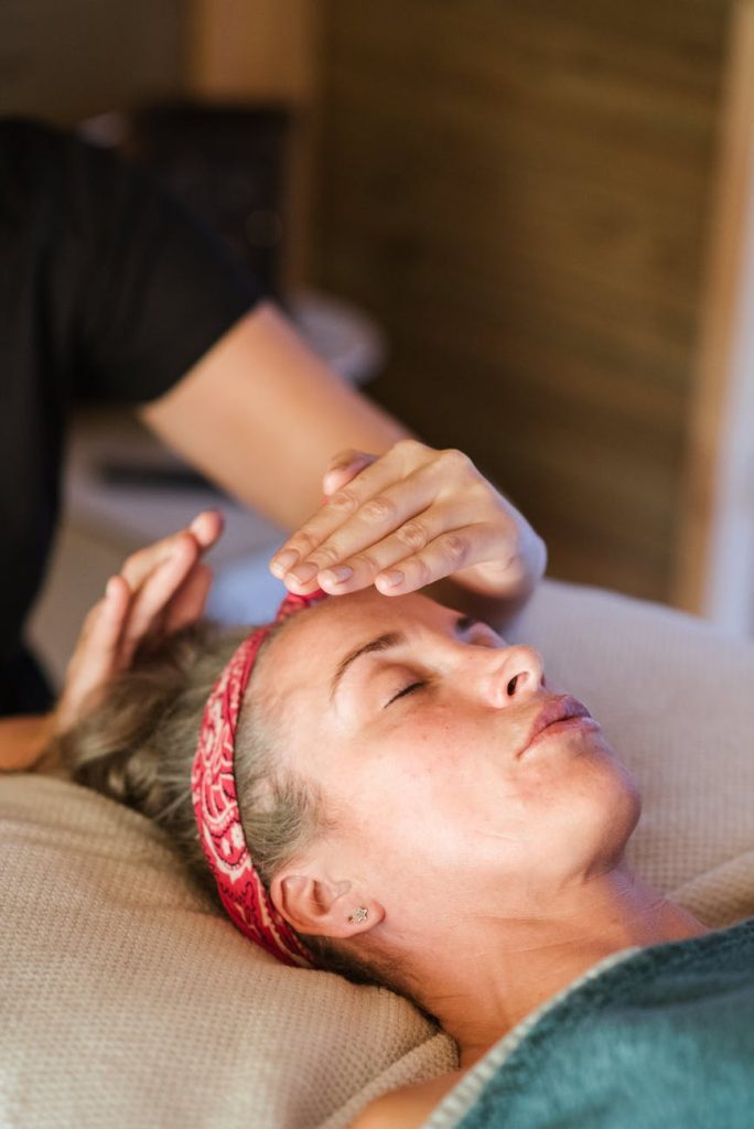 relaxed woman having a Reiki treatment